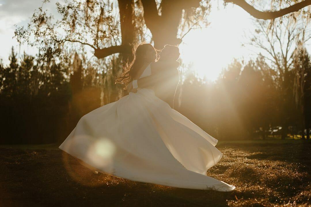 Bride and Groom dancing in the sun